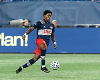 FOXBOROUGH, MA - OCTOBER 3: DeJuan Jones #24 of New England Revolution brings the ball forward during a game between Nashville SC and New England Revolution at Gillette Stadium on October 3, 2020 in Foxborough, Massachusetts.