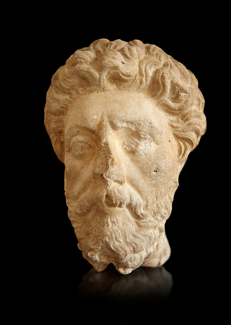 Roman sculpture of the Emperor Marcus Aurelius, excavated  from Carthage made circa 161-180 AD. The Bardo National Museum, Tunis, Inv No: C.965.  Against a black background.