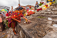 south America, Guatemala. Chichicastenango, maya woman prepare fire for celebrations on the steps of the church of Santo Tomás