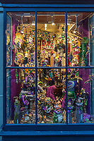 French Quarter, New Orleans, Louisiana.  Artistic and Party Paraphernalia on Display in a Shop Window.