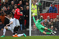 Lukasz Fabianski of Swansea City is beaten by the shot by Romelu Lukaku of Manchester United during the Premier League match between Manchester United and Swansea City at the Old Trafford, Manchester, England, UK. Saturday 31 March 2018