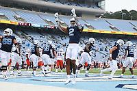 CHAPEL HILL, NC - OCTOBER 10: Dyami Brown #2 of North Carolina celebrates after a touchdown during a game between Virginia Tech and North Carolina at Kenan Memorial Stadium on October 10, 2020 in Chapel Hill, North Carolina.