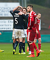 Dundee's James McPake (5) and Simon Ferry celebrate at the end of the game in front of a dejected David Goodwillie.