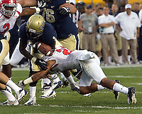 Youngstown State Cornerback Dale Peterman forces a fumble by Pitt running back Ray Graham. . The Youngstown St. Penguins defeated the Pittsburgh Panthers 31-17 on Saturday, September 1, 2012 at Heinz Field in Pittsburgh, PA.