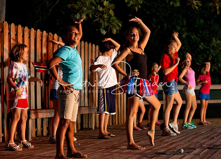 Camper at YMCA Camp Thunderbird perform on stage for other campers during the closing ceremony event at the Charlotte-area YMCA camp. YMCA resident Camp Thunderbird, operating since 1936, is one of several YMCA camps located in the Carolinas. The 100-acre camp is located about 20 minutes from downtown Charlotte, North Carolina.