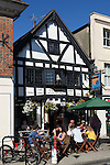 Great Britain, England, Hampshire, Winchester: People enjoying a drink outside The Eclipse Inn, dating back to the 16th century