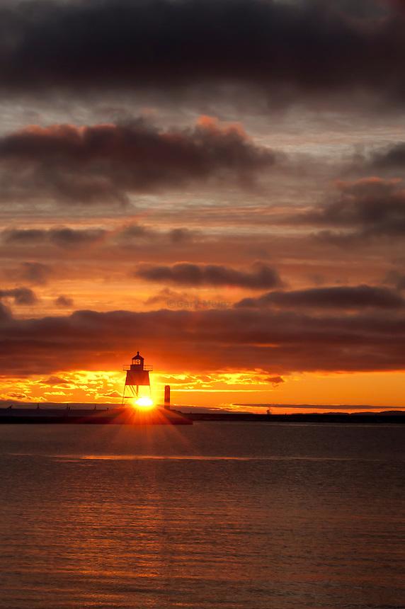 Sunset behind the Grand Marais, Minnesota lighthouse.