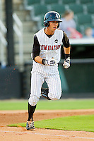 David Herbek #12 of the Kannapolis Intimidators hustles down the first base line against the Augusta GreenJackets at CMC-Northeast Stadium on May 2, 2012 in Kannapolis, North Carolina.  The GreenJackets defeated the Intimidators 9-6.  (Brian Westerholt/Four Seam Images)
