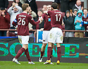 HEARTS' CRAIG BEATTIE IS CONGRATULATED BY MARIUS ZALIUKAS AND RYAN MCGOWAN AFTER HE HEADS HOME HEARTS' FIRST GOAL
