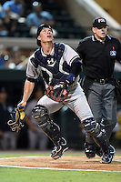 Tampa Yankees catcher Peter O'Brien (24) tracks a pop up in front of umpire Ryan Benson during a game against the Lakeland Flying Tigers on April 3, 2014 at Joker Marchant Stadium in Lakeland, Florida.  Tampa defeated Lakeland 4-0.  (Mike Janes/Four Seam Images)