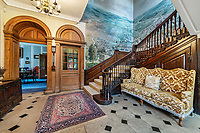 BNPS.co.uk (01202 558833)<br /> Pic: KnightFrank/BNPS<br /> <br /> Pictured: The hall.<br /> <br /> A spectacular Georgian mansion that was home to an eccentric and legendary poet during the war is on the market for £10.5m.<br /> <br /> Grade II* Listed South End House was home to Walter de la Mare in the 1940s and the writer was reprimanded for failing to observe the blackout during the Second World War.<br /> <br /> The impressive property is in a prime location on an exclusive cul-de-sac with incredible park views and glimpses of the Thames.<br /> <br /> On one occasion during the war, police rowed across the river to complain his upper windows were beaconing to the far bank.
