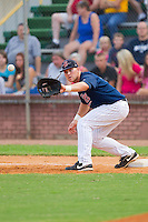 First baseman Brian Burke #9 of the Elizabethton Twins stretches for a throw at Joe O'Brien Field August 14, 2010, in Elizabethton, Tennessee.  Photo by Brian Westerholt / Four Seam Images
