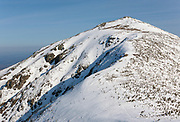 The summit of Mount Lafayette from the Appalachian Trail (Franconia Ridge Trail) in the White Mountains of New Hampshire USA during the winter months.