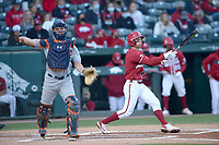 Arkansas second baseman Robert Moore reacts Friday, April 2, 2021, after striking out during the first inning as Auburn catcher Ryan Dyal throws the ball around the infield at Baum-Walker Stadium in Fayetteville. Visit nwaonline.com/210403Daily/ for today's photo gallery. <br /> (NWA Democrat-Gazette/Andy Shupe)
