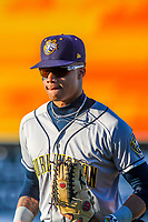 Burlington Bees outfielder Jordyn Adams (2) heads into the dugout between innings during a Midwest League game against the Wisconsin Timber Rattlers on April 26, 2019 at Fox Cities Stadium in Appleton, Wisconsin. Wisconsin defeated Burlington 2-0. (Brad Krause/Four Seam Images)