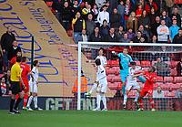 Saturday 10 November 2012<br /> Pictured: Gerhard Tremmell, goalkeeper for Swansea (in blue) gets the ball away with his fists from a Southampton attack<br /> Re: Barclay's Premier League, Southampton FC v Swansea City FC at St Mary's Stadium, Southampton, UK.