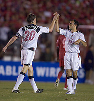 Landon Donovan and captain Brian McBride congratulate each other after McBride's goal against Panama in the first half in Panama City, Panama, Wednesday, June 8, 2005.
