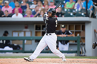 Micah Johnson (3) of the Charlotte Knights follows through on his swing against the Columbus Clippers at BB&T BallPark on May 27, 2015 in Charlotte, North Carolina.  The Clippers defeated the Knights 9-3.  (Brian Westerholt/Four Seam Images)