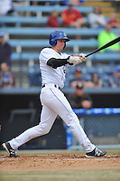 Asheville Tourists third baseman Ryan McMahon #5 swings at a pitch during a game against the  Delmarva Shorebirds at McCormick Field on April 6, 2014 in Asheville, North Carolina. The Shorebirds defeated the Tourists 4-2. (Tony Farlow/Four Seam Images)