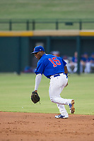 AZL Cubs second baseman Yonathan Perlaza (15) warms up between innings during a game against the AZL Brewers on August 1, 2017 at Sloan Park in Mesa, Arizona. Brewers defeated the Cubs 5-4. (Zachary Lucy/Four Seam Images)