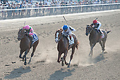 Shackleford, center, fights off Caleb's Posse, left, as To Honor And Serve gives way.