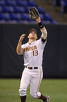 Minnesota Golden Gophers outfielder Andy Henkemeyer #13 catches a fly ball during a game against the Texas Longhorns at the Metrodome on March 22, 2013 in Minneapolis, Minnesota. (Brace Hemmelgarn/Four Seam Images)