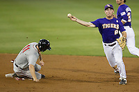 LSU Tigers shortstop Alex Bregman #8 turns a double play during the Southeastern Conference baseball game against the Georgia Bulldogs on March 22, 2014 at Alex Box Stadium in Baton Rouge, La. The Tigers defeated the Bulldogs 2-1. (Andrew Woolley/Four Seam Images)