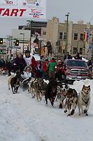 2010 Iditarod Ceremonial Start in Anchorage Alaska musher # 21 RAMEY SMYTH with Iditarider YVONNE OOTEN