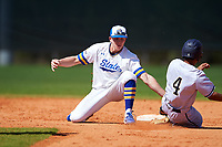 South Dakota State Jackrabbits shortstop Gus Steiger (3) tags Kobe Lopez (4) sliding into second base during a game against the FIU Panthers on February 23, 2019 at North Charlotte Regional Park in Port Charlotte, Florida.  South Dakota State defeated FIU 4-3.  (Mike Janes/Four Seam Images)