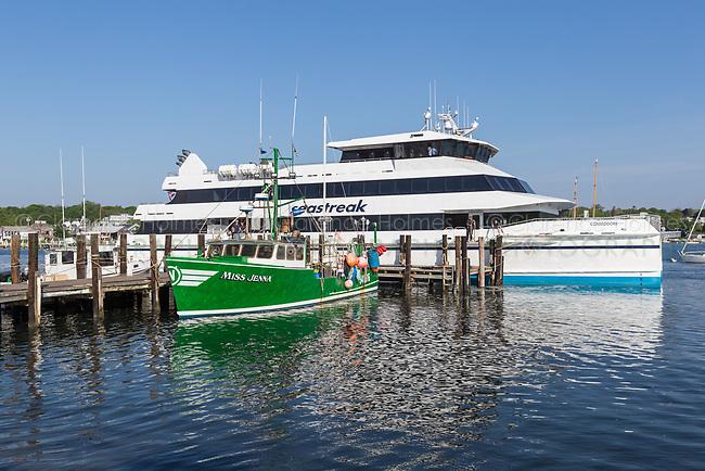 "Commercial fishing boat ""Miss Jenna"" docked next to a Seastreak ferry in Vineyard Haven Harbor, in Tisbury, Massachusetts on Martha's Vineyard."