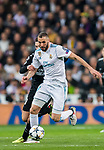 Karim Benzema (R) of Real Madrid fights for the ball with Giovani Lo Celso of Paris Saint Germain during the UEFA Champions League 2017-18 Round of 16 (1st leg) match between Real Madrid vs Paris Saint Germain at Estadio Santiago Bernabeu on February 14 2018 in Madrid, Spain. Photo by Diego Souto / Power Sport Images