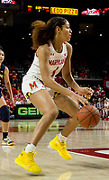 COLLEGE PARK, MD - DECEMBER 28: Shakira Austin #1 of Maryland dribbles forward. during a game between University of Michigan and University of Maryland at Xfinity Center on December 28, 2019 in College Park, Maryland.