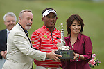 3rd June 2012 - Celtic Manor Resort - Newport - South Wales - UK :   Jaidee Thongchai of Thialand is presented the winner's trophy by Sir Terry Matthews and Midori Miyazaki (ISPS Handa) at the ISPS Handa Wales Open Golf Tournament at the Celtic Manor Resort..