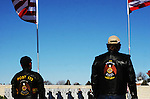 CHAD PILSTER •Hays Daily News<br /> <br /> Hays VFW Post 9076 perform a 21 gun salute as the American Legion Riders from Post 173 watch on Saturday, December 14, 2013 during the Wreaths Across America event at the Kansas Veterans' Cemetery in WaKeeney, Kansas. Wreaths were donated to put on all of the graves at the cemetery. This is the 22nd anniversary of the Worcester Wreath Company donating Maine wreaths to the Nation's veterans at Arlington National Cemetery.