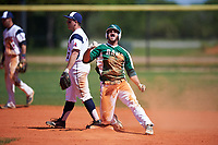 Farmingdale State Rams Vincent Rice (30) pumps his fist after hitting a double during the first game of a doubleheader against the FDU-Florham Devils on March 15, 2017 at Lake Myrtle Park in Auburndale, Florida.  Second baseman Joseph Bonaccorso (7) is to the left covering the bag.  Farmingdale defeated FDU-Florham 6-3.  (Mike Janes/Four Seam Images)