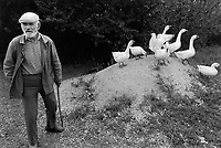 """Russia. Krasnodar Krai Region. Krasnodar. Old man and geese. The elderly man is working as a farmer in a new large private farm on what used to be a sovkhoz farm. A sovkhoz was a form of state-owned farm in the Soviet Union. It is usually contrasted with kolkhoz, which is a collective-owned farm. Unlike the members of a kolkhoz, which were called """"kolkhozniks"""" or """"kolkhozniki"""" (the workers of a sovkhoz were only colloquially called """"sovkhozniki"""". A goose (plural geese) is a bird of any of several waterfowl species in the family Anatidae. Krasnodar (also known as Kuban) is the largest city and the administrative centre of Krasnodar Krai in Southern Russia. 21.09.1993 © 1993 Didier Ruef"""