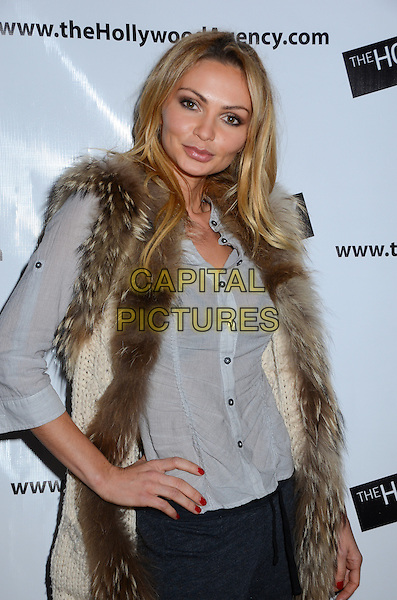 """Gia Skova.The Hollywood Agency presents a private after party for People's Choice Awards 2012 hosted by Mario Lopez of NBC's """"Extra"""" held at Conga Room L.A. Live, Los Angeles, California, USA..January 11th, 2012.half length blue shirt white gilet sleeveless jacket brown fur trim hand on hip.CAP/ADM/BT.©Birdie Thompson/AdMedia/Capital Pictures."""