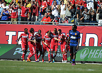 Chicago Fire defender Cory Gibbs (5) celebrates his header goal with his teammates.  Manchester United defeated the Chicago Fire 3-1 at Soldier Field in Chicago, IL on July 23, 2011.