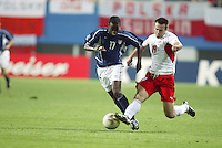 DaMarcus Beasley battles for possession of the ball. The USA lost 3-1 against Poland in the FIFA World Cup 2002 in Korea on June 14, 2002.