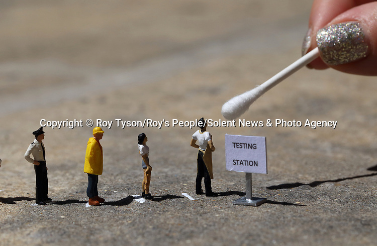 Pictured: Testing<br /> <br /> Tiny figurines give a new perspective on everyday objects as they are posed interacting with them in their miniature world.  Artist Roy Tyson creates witty and intriguing imagery with customised miniature figures, under the name Roy's People.<br /> <br /> Since 2012, he has been photographing his miniature world on the streets of London and beyond.  SEE OUR COPY FOR DETAILS.<br /> <br /> Please byline: Roy Tyson/Roy's People/Solent News<br /> <br /> © Roy Tyson/Roy's People/Solent News & Photo Agency<br /> UK +44 (0) 2380 458800