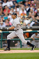Johnny Damon of the New York Yankees follows through on his swing versus the Detroit Tigers at Comerica Park April 27, 2009 in Detroit, Michigan.  Photo by Brian Westerholt / Four Seam Images