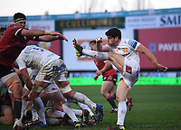 26th March 2021; Kingsholm Stadium, Gloucester, Gloucestershire, England; English Premiership Rugby, Gloucester versus Exeter Chiefs; Sam Hidalgo-Clyne of Exeter Chiefs kicks under pressure from Tom Price of Exeter Chiefs