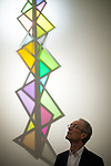 """© Joel Goodman - 07973 332324 . 13/02/2015 .  Manchester , UK . Artist DAVID BATCHELOR and the illuminated shadow of his sculpture """" Plato's Disco """" , which was specifically commissioned for the space . Opening of the newly refurbished Whitworth Gallery on Oxford Road in Manchester , following a £15 million refurbishment and expansion . Photo credit : Joel Goodman"""