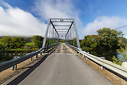 The Janice Peaslee Bridge in Stratford, New Hampshire during the autumn months. This bridge crosses the Connecticut River and connects the town of Maidstone, Vermont and Stratford, New Hampshire.