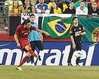 Portugal substitute Lica (10) centers the ball. In an international friendly, Brazil (yellow/blue) defeated Portugal (red), 3-1, at Gillette Stadium on September 10, 2013.