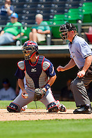 Gwinnett Braves catcher Matt Pagnozzi (19) blocks a pitch in the dirt as home plate umpire Toby Basner looks on during the International League game against the Charlotte Knights at Knights Stadium on July 28, 2013 in Fort Mill, South Carolina.  The Knights defeated the Braves 6-1.  (Brian Westerholt/Four Seam Images)