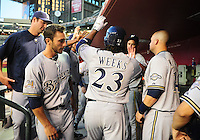 May 7, 2010; Phoenix, AZ, USA; Milwaukee Brewers second baseman (23) Rickie Weeks is congratulated after hitting a home run in the third inning against the Arizona Diamondbacks at Chase Field. Mandatory Credit: Mark J. Rebilas-