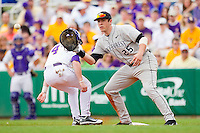 First baseman Matt Conway #25 of the Wake Forest Demon Deacons waits for a pick-off throw as Raph Rhymes #4 of the LSU Tigers gets back to the base safely at Alex Box Stadium on February 19, 2011 in Baton Rouge, Louisiana.  The Tigers defeated the Demon Deacons 4-3.  Photo by Brian Westerholt / Four Seam Images