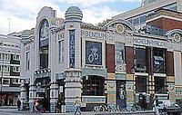 "London: Michelin Building. ""Bibendum"" or ""BIB"", the Tire Man, from ""Nunc est Bibendum"" or Now is the time to drink.  Photo 2005."