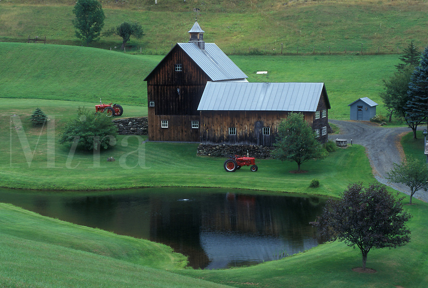barn, Vermont, VT, Scenic Sleepy Hollow Farm in South Pomfret. Two red tractors parked outside barn.